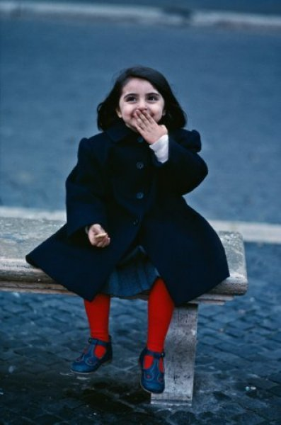 A Little Girl Laughing at St. Pauls Cathedral