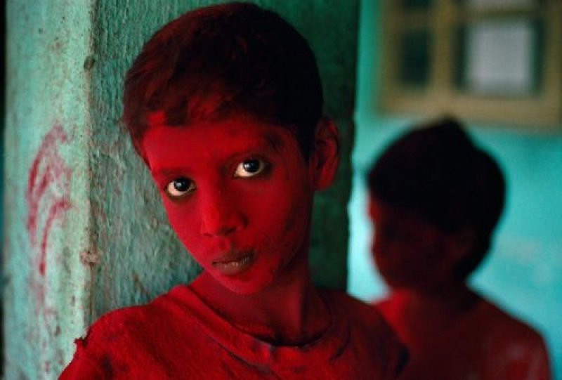 Red Boy During Holi Festival